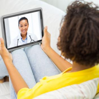 woman having medical consultation online with female doctor